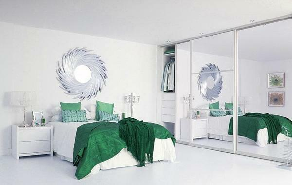 Mirror cabinet in the bedroom will help visually increase the space