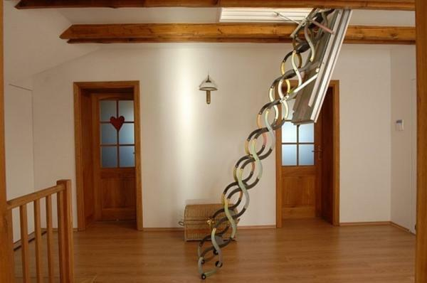 A sliding staircase to the second floor allows you to save a lot of space in the room