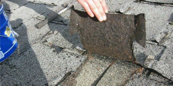 Strong wind simply tears off pieces of cheap low-quality roofing materials
