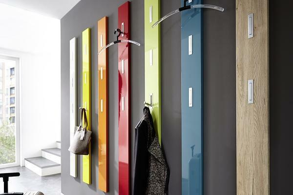 Multicolored hangers perfectly fit in the interior of the hallway, which is made in the style of high-tech