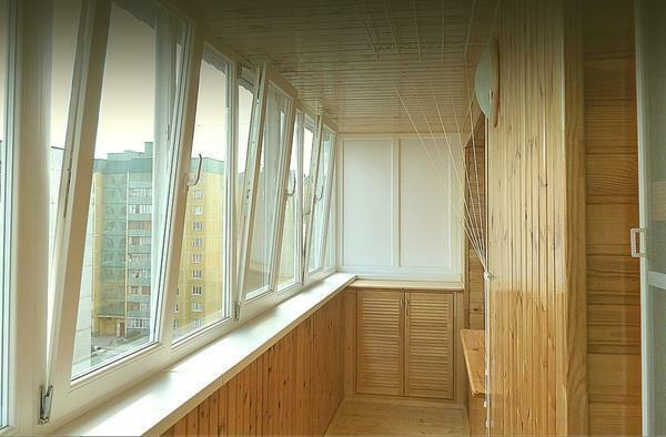 Interior paneling of the balcony with wood is inexpensive and environmentally friendly