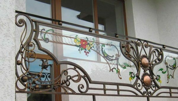 Forged fences on the balconies with glass inserts