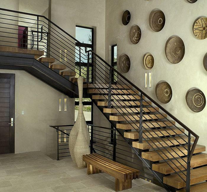Stylish staircase can not only decorate the interior, but also become a bright accent in the interior