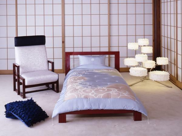 Japanese style is good for small bedrooms, because it involves the use of a minimum amount of furniture