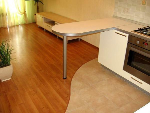 Selecting a laminate for the kitchen-hallway, you should consider the size and features of the room