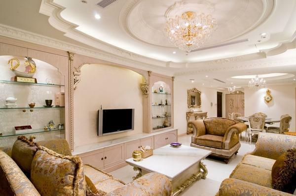Before making a plasterboard ceiling in the living room, you must first determine its design and lighting