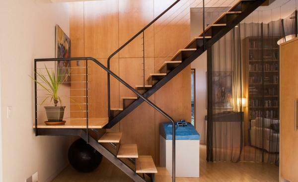 The type of stairs designers recommend choosing, taking into account the characteristics of the room, where it will be mounted