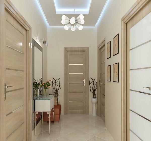 For narrow corridors, an excellent solution is to cover the walls with light wallpaper, which visually make the room larger