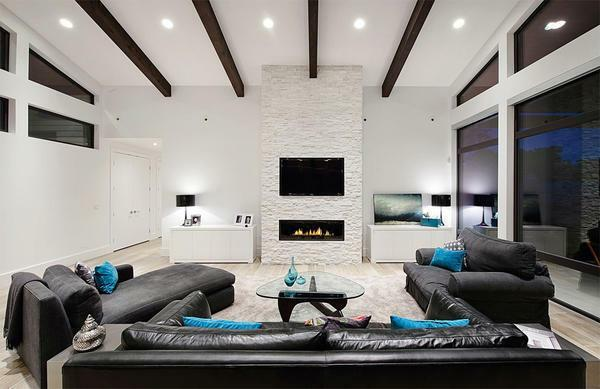 Living room in turquoise colors: the color in the interior is brown, a photo of a gray room with accents of chocolate-beige