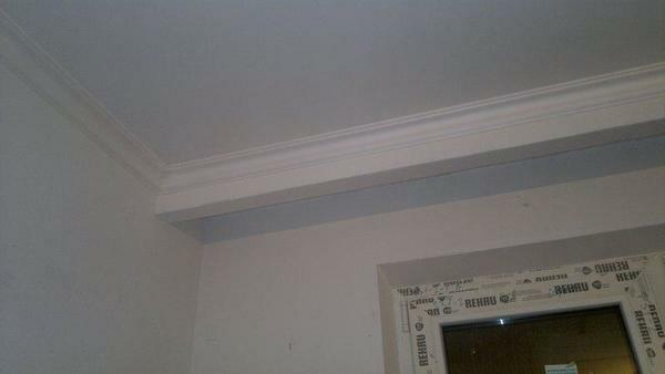 A hidden cornice made of plasterboard should be installed securely and firmly to support the weight of the curtains