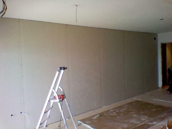 Decorating walls with plasterboard without a frame is a process that will help to save space