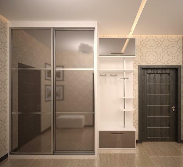 A large beautiful wardrobe with mirrored doors will perfectly cope with the task of visual expansion of space in a small hallway