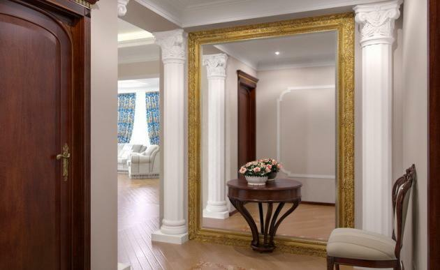 Make the entrance hall beautiful and original will help a large mirror on the whole wall