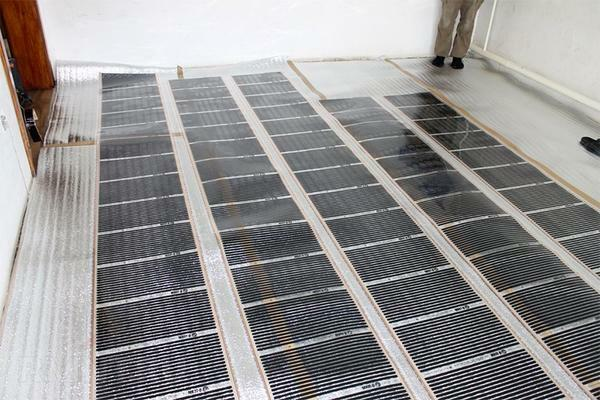 Lay the infrared film warm floor under the linoleum - it is at least economically justified