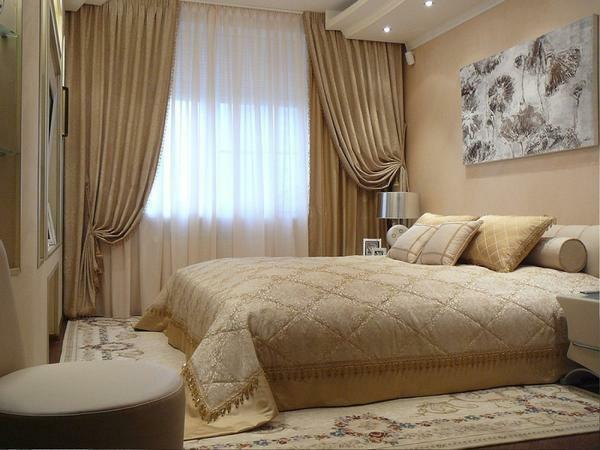 An excellent solution is to buy a classic bedroom curtains, which are made of gold or beige fabric