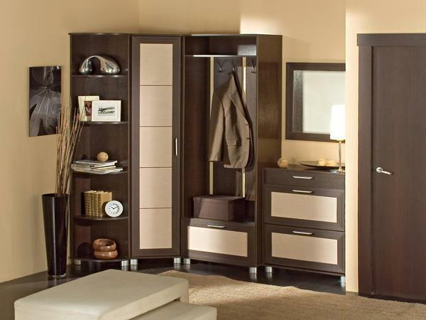 It is worth choosing such a corner cabinet in the hallway, which will accommodate the things of all family members