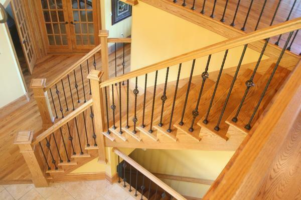 Railings for stairs made of wood: wooden with own hands, poles and photos, installation of carved, fastening manufacturing