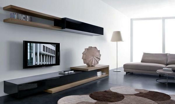 The modern living room should have a soft sofa, a small shelving and several original accessories
