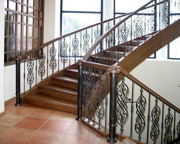 A beautiful staircase with forged rails will not only decorate the interior, but also make it elegant and elegant