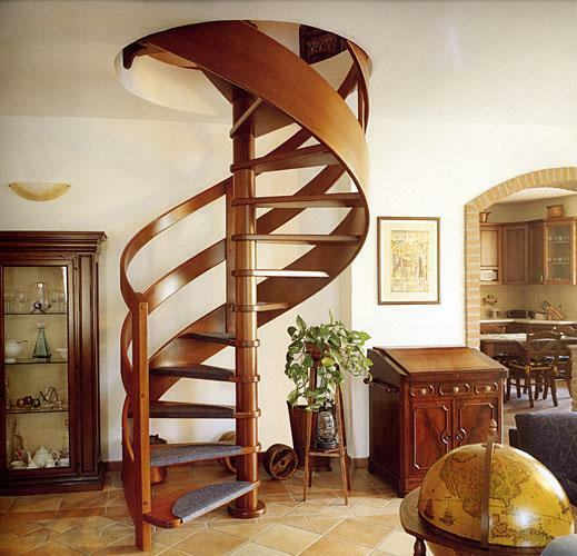 Stylishly complement the interior of the room in both classical and modern style can be using a spiral staircase