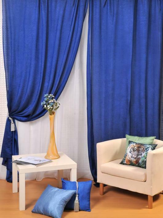 Blue curtains will bring freshness and lightness to the interior of any room