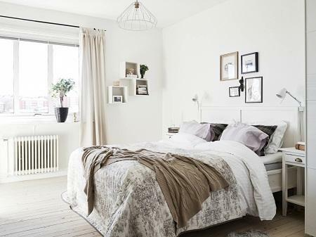 The bedroom, executed in the Scandinavian style, looks elegant and at the same time strictly