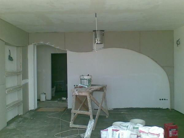 Select the design of plasterboard walls, taking into account the size and features of the room