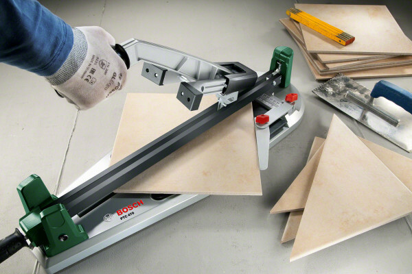 In the photo: Hand tool allows you to quickly and accurately cut tile