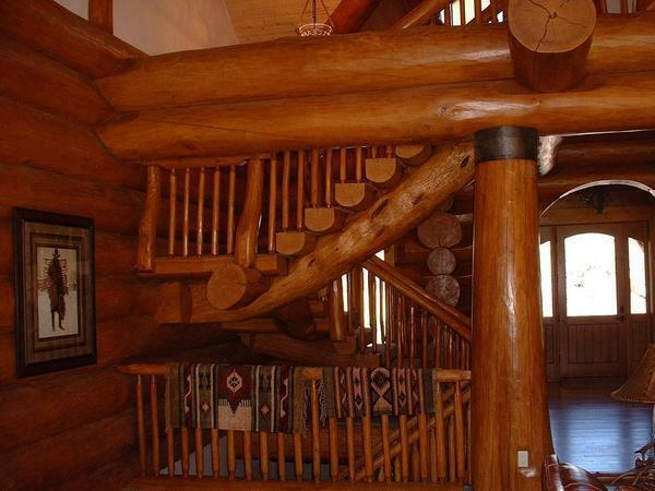 Among the advantages of stairs from logs it is worth noting excellent aesthetic qualities and environmental friendliness