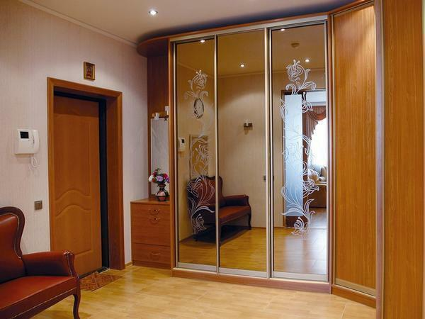 If you need to visually increase the space in the hallway, then you can choose a stylish wardrobe with mirrored doors