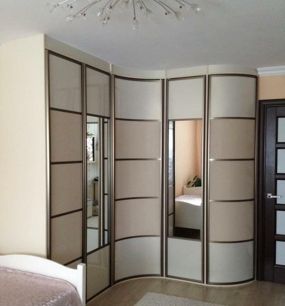 The corner wardrobe can be selected from the photos in the catalog