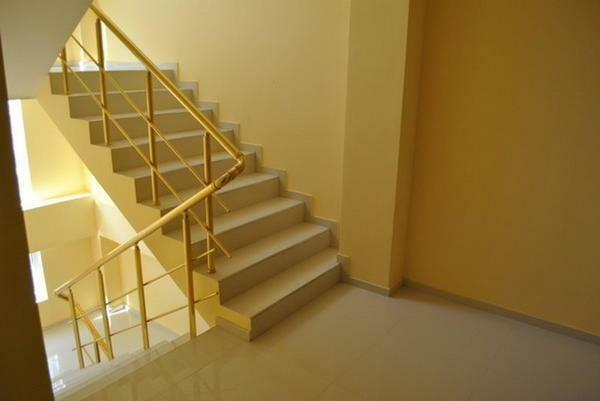 The staircase in the entrance can be arranged in such a way that it will please all the residents of the house