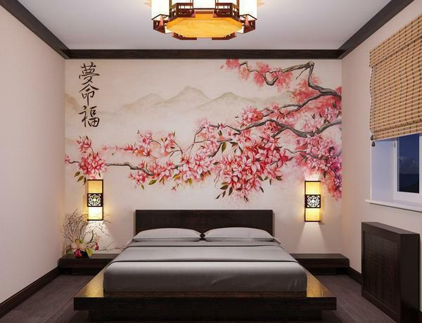 An excellent solution is to use wallpaper with an image of cherry in the bedroom, made in Japanese style