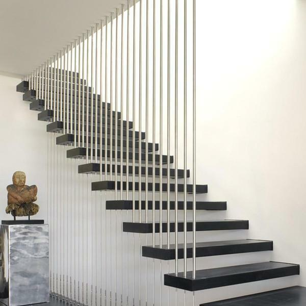 An excellent solution for the interior, made in the style of high-tech or modern, is the use of stairs, the steps of which are attached to the wall