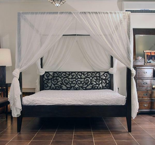 For classical interiors the canopy design on an adult bed with carved wooden supports