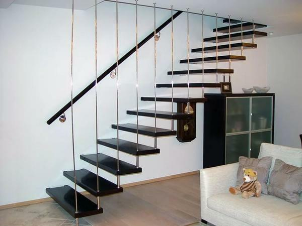 In a small hall it is advisable to install a staircase leading to the second floor