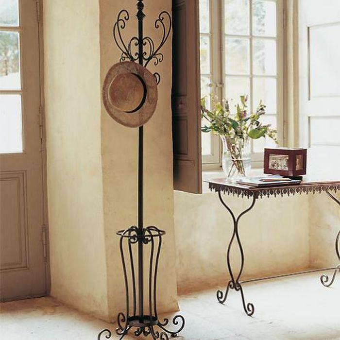 Wrought iron hangers in the hall: metal photo, wall and floor, for the dress of the banquet, the parameters of the angular
