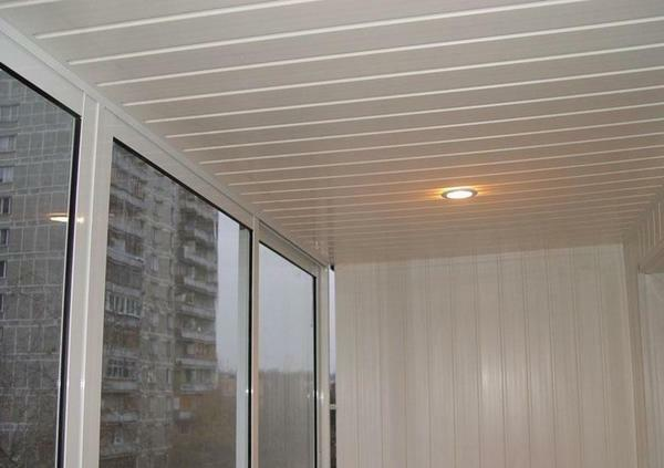 Plastic panels are the best material for finishing the ceiling on the balcony
