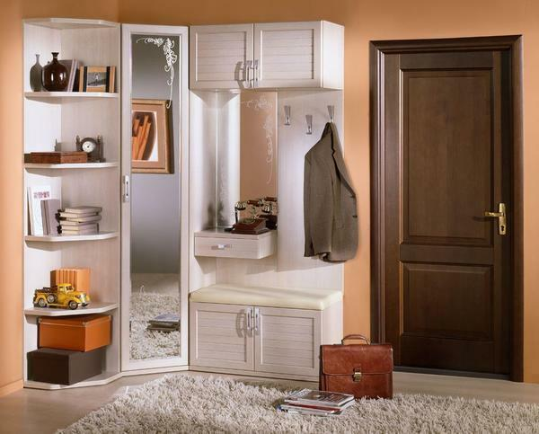 For a small hallway, an excellent option is a compact corner cabinet