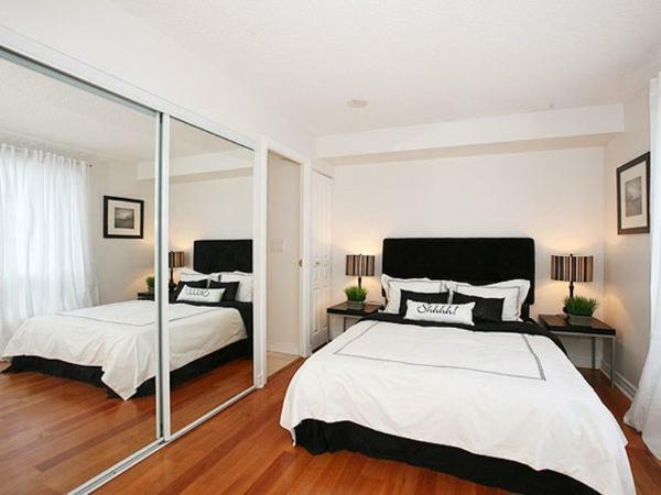 Visually increase the space of the room will help mirror surfaces installed on one of the bedroom walls
