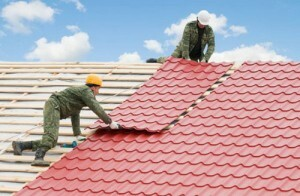 Repair of the roof of a private house: repairing the roof of metal and slate cottage