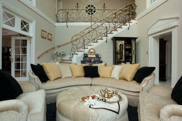 Beautiful staircase in classical style will make the interior of the living room exquisite