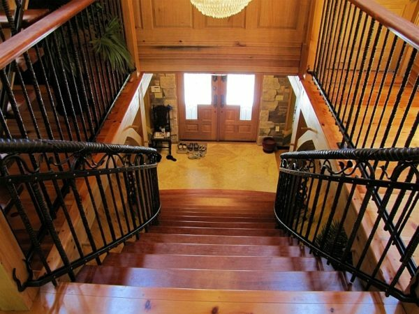 Wrought iron balustrade emphasizes living warmth of wood