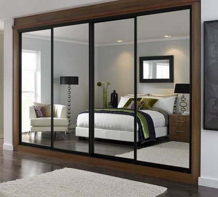 The wardrobe with mirrored doors is not only practical furniture, but also acts as a modern piece of furniture