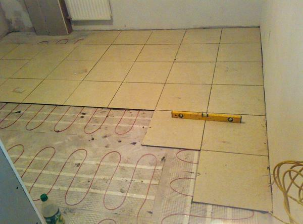 Warm floor under the tile: electric and infrared, cable and which is better for tile, styling options