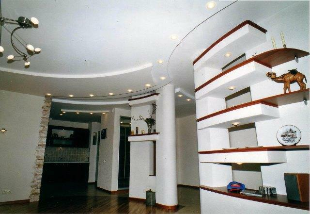 Gypsum plasterboard shelves in the interior create a special color, allow you to successfully place all the necessary items