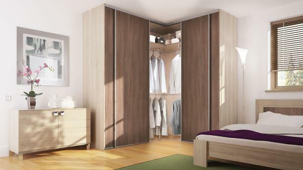 Often, it is difficult to choose a corner wardrobe in the bedroom