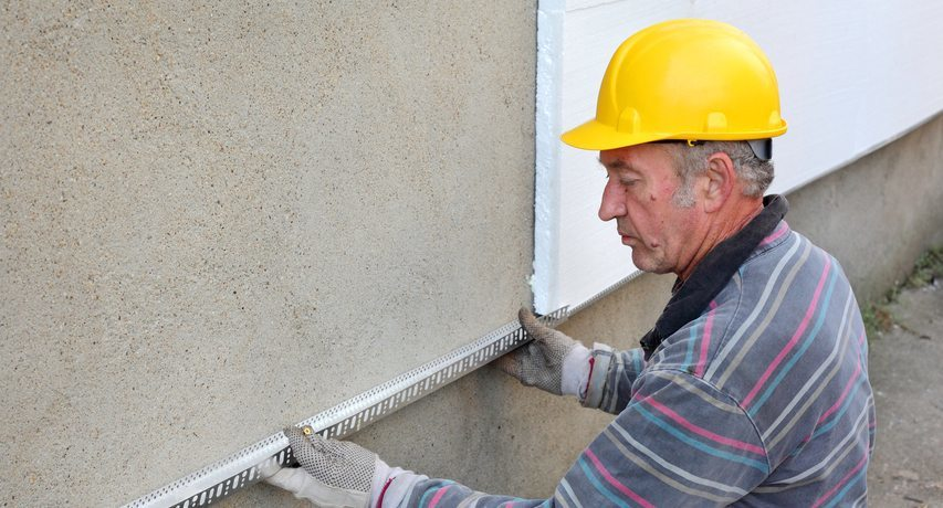 Polystyrene insulation of walls outside their own hands, video