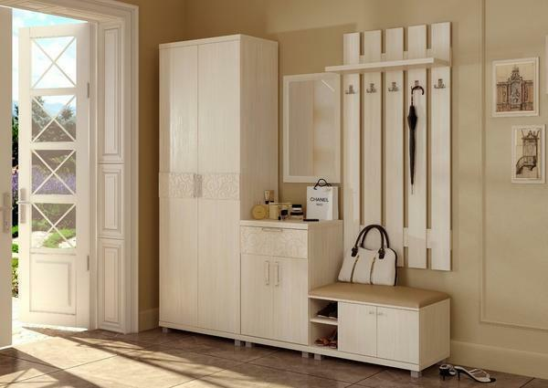 Wooden decorative wardrobe, painted in white, fits perfectly into the classic interior
