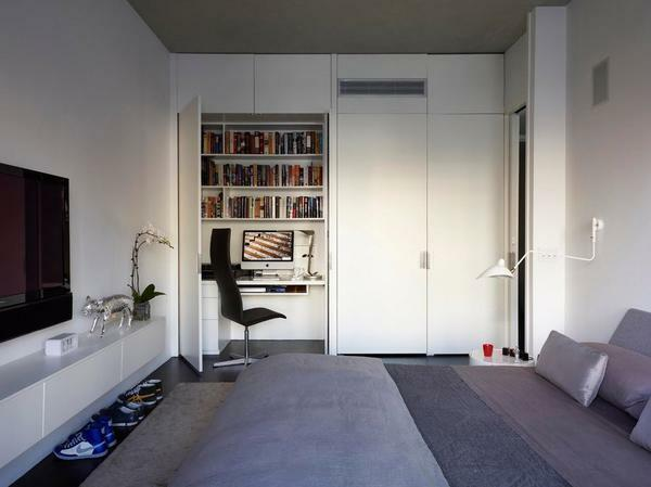 It is nice and practical to divide the sleeping and working areas with a partition or furniture